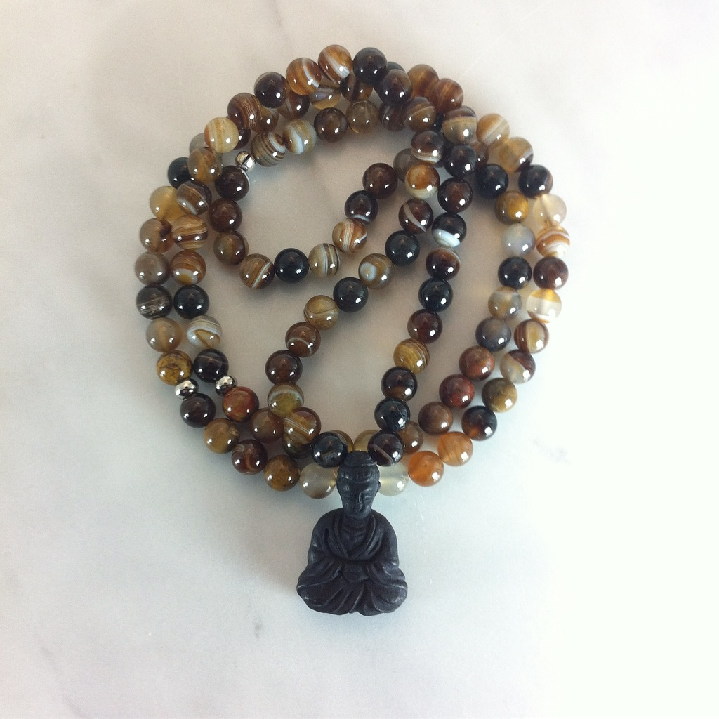 Wood agate mala beads are excellent for grounding, vitality, creativity, and opening the root chakra.