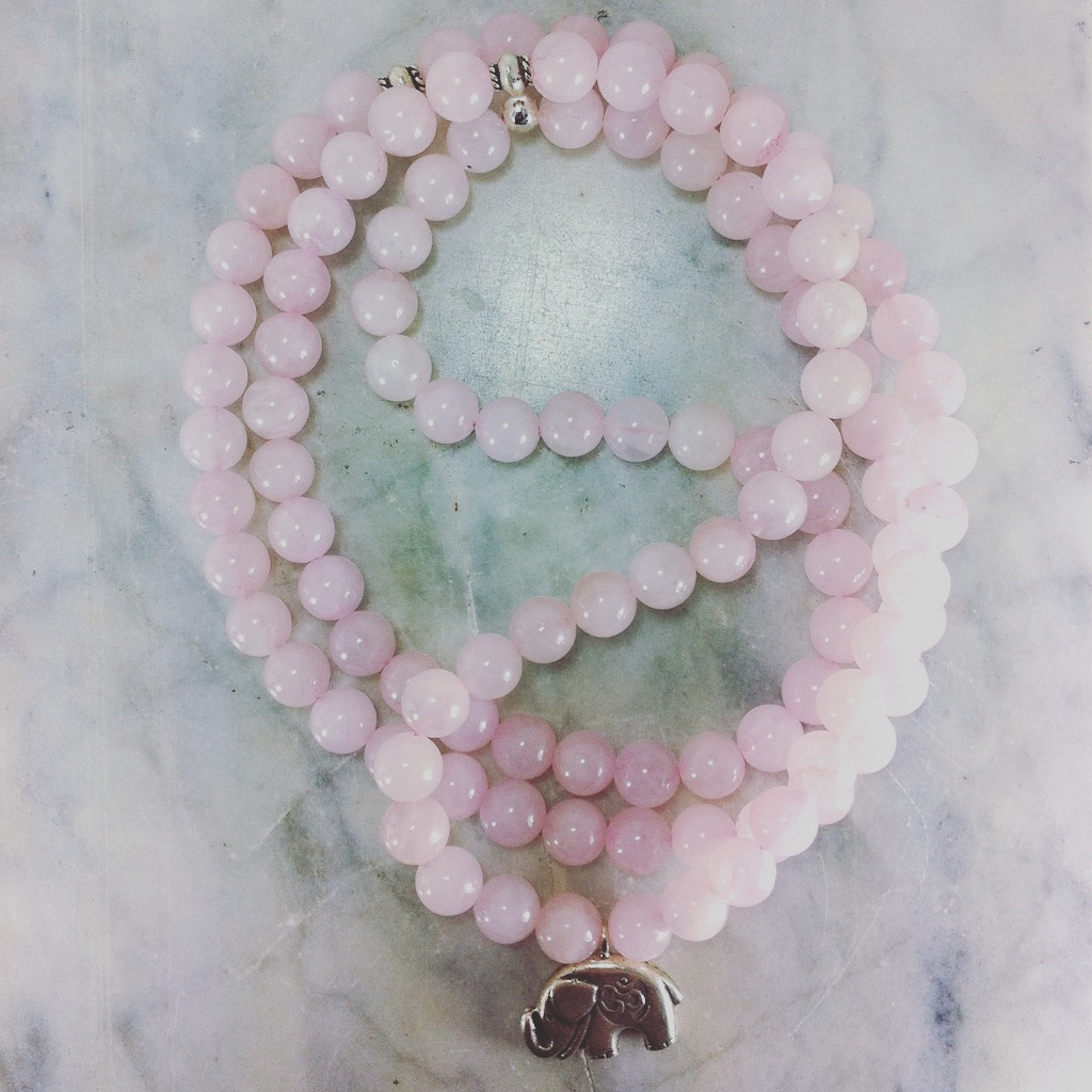 Rose quartz mala beads for love, hope, and healing the heart.