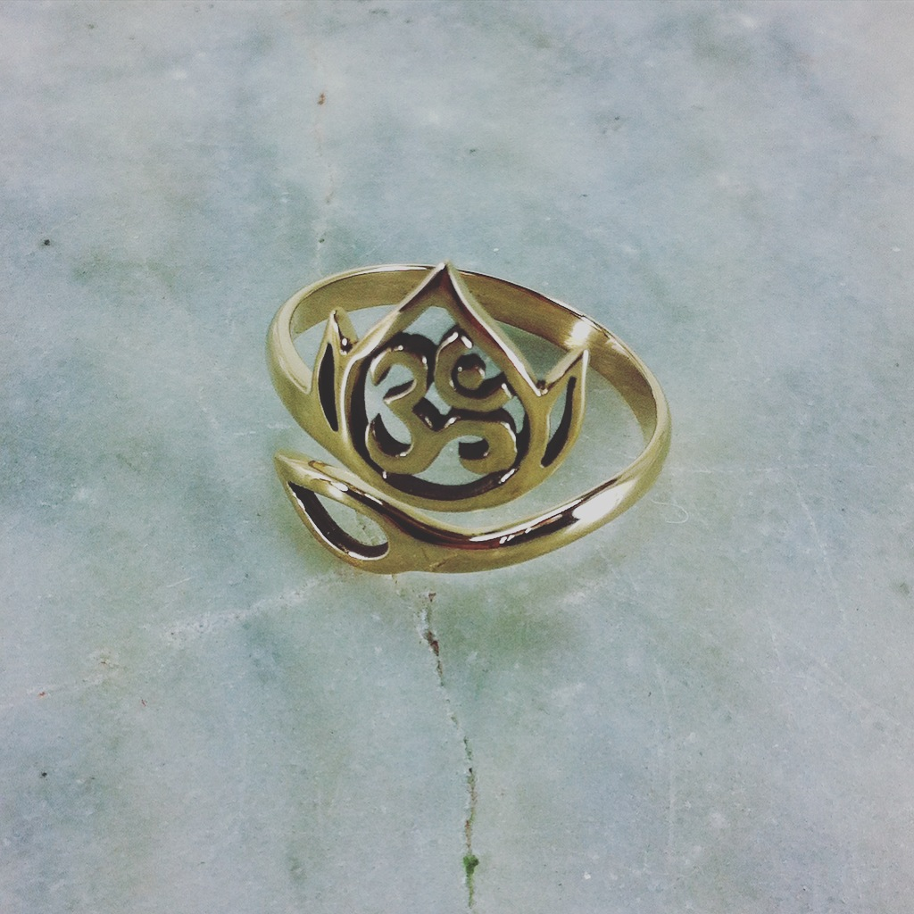 Yoga Ring made from bronze and features an OM withing a blooming lotus.  This yoga jewelry is best for: Awareness, awakening, symbol of the blooming of the thousand petal lotus at the crown of the head.