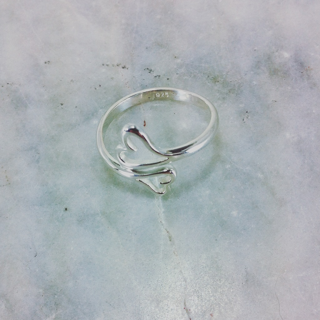 Yoga ring of two hearts meeting symbolic of love.