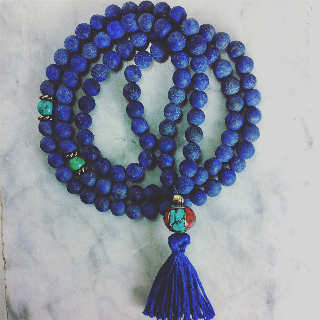 Mala beads from lapis lazuli for deepening meditation, royal virtue, and serenity.
