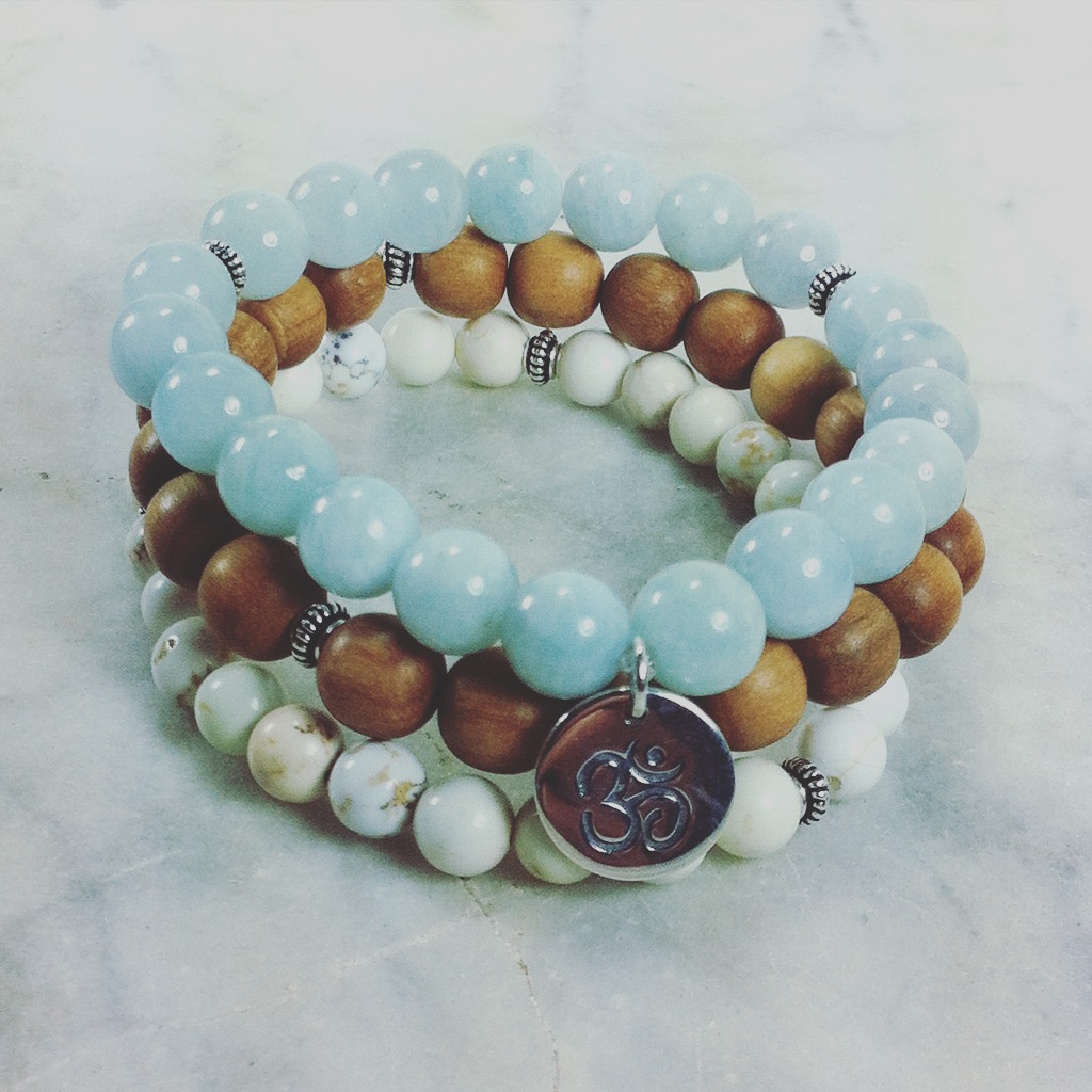 Mala Beads Stack is made from 21 aquamarine, sandalwood and howlite mala beads. Silver is added for color. It is completed with a sterling silver OM symbolizing oneness. Buddhist Bracelet is best for soothing, calming, and relieving anxiety