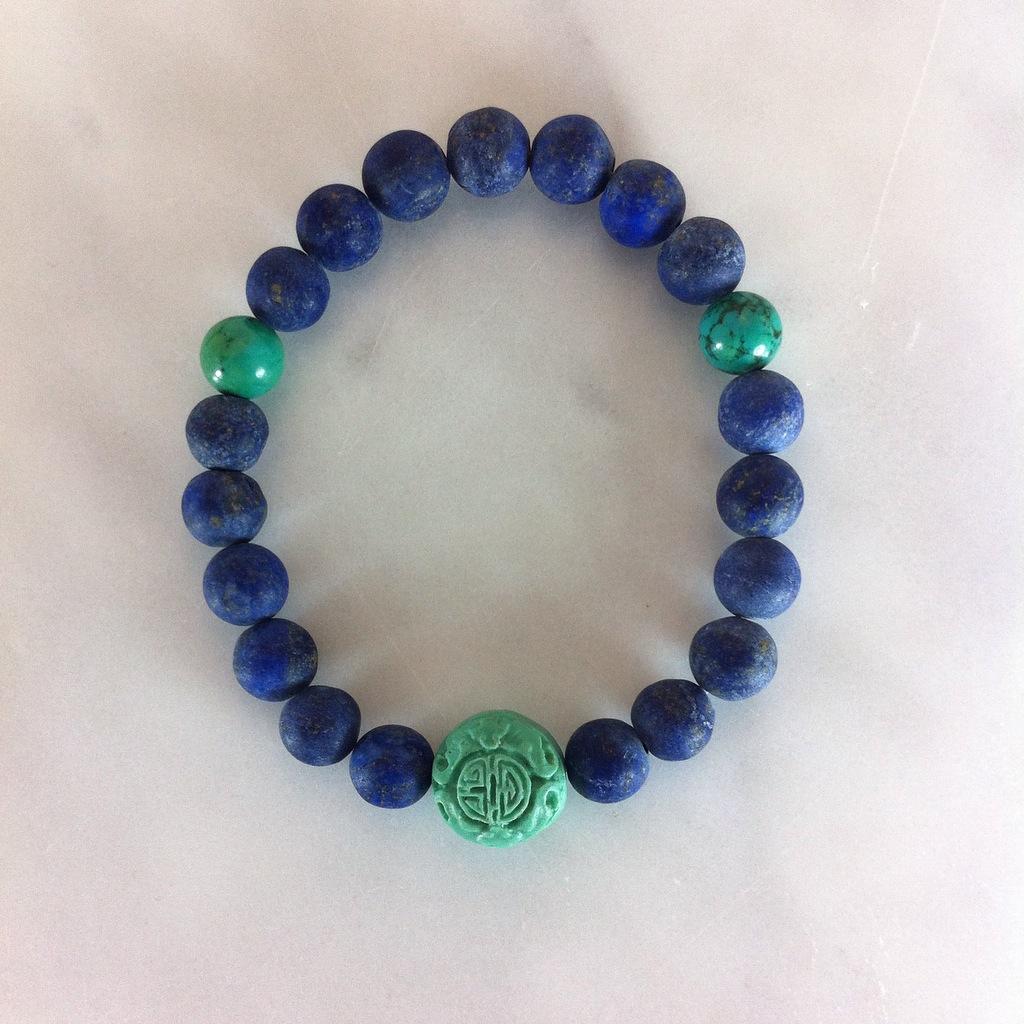 Mala beads bracelet with lapis lazuli, turquoise, and cinnabar.