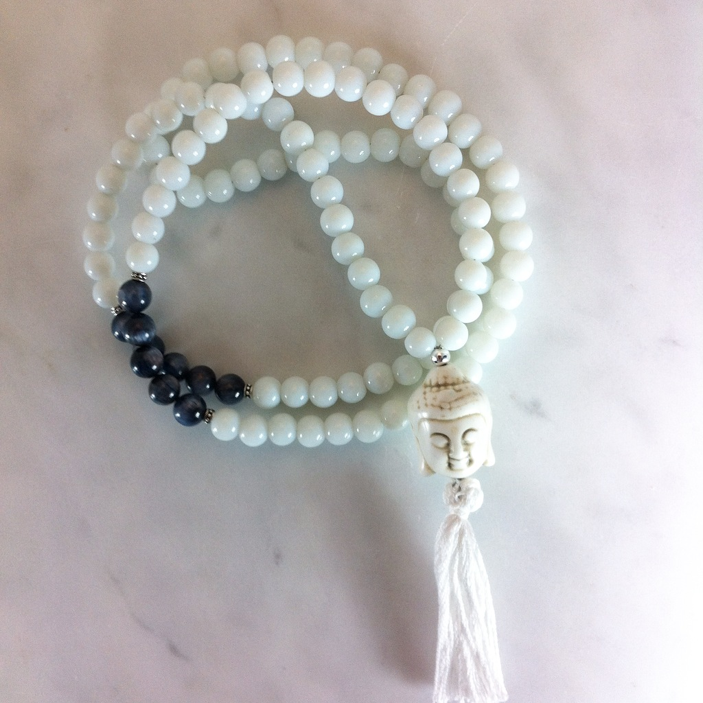 These mala beads are made with white jade and deep blue kyanite.