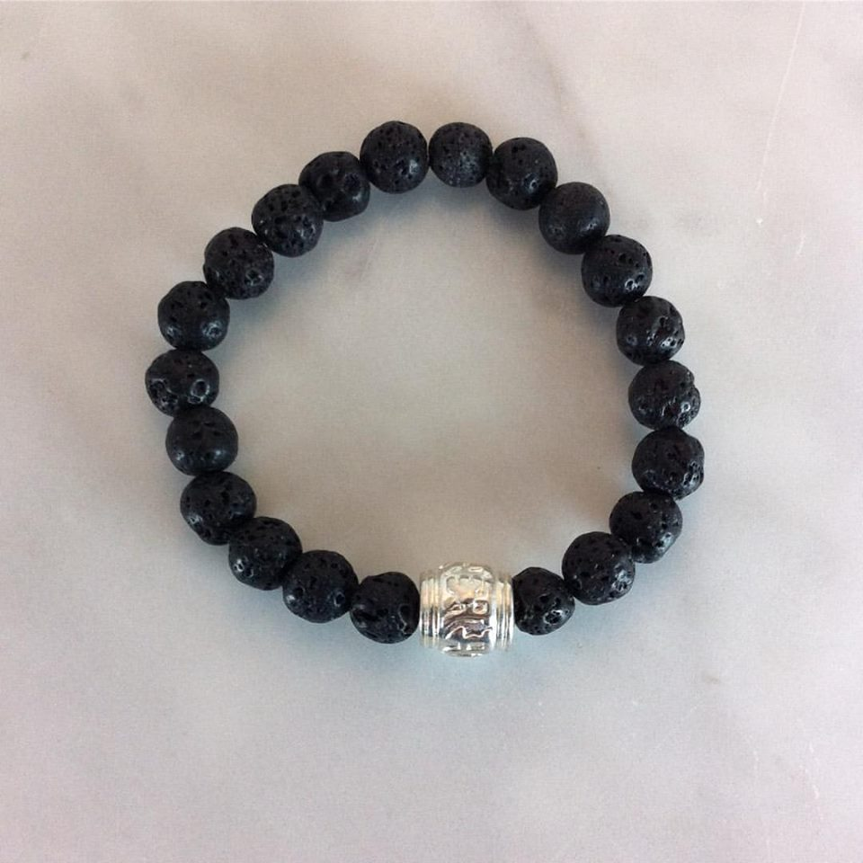 This bold mala bracelet is made from black lava and Tibetan silver. The guru bead has the om mani padme hum mantra.