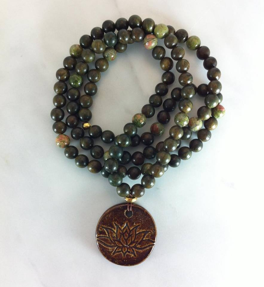 One of a kind. These mala beads are made from green sandalwood and unakite jasper with a handmade clay lotus.