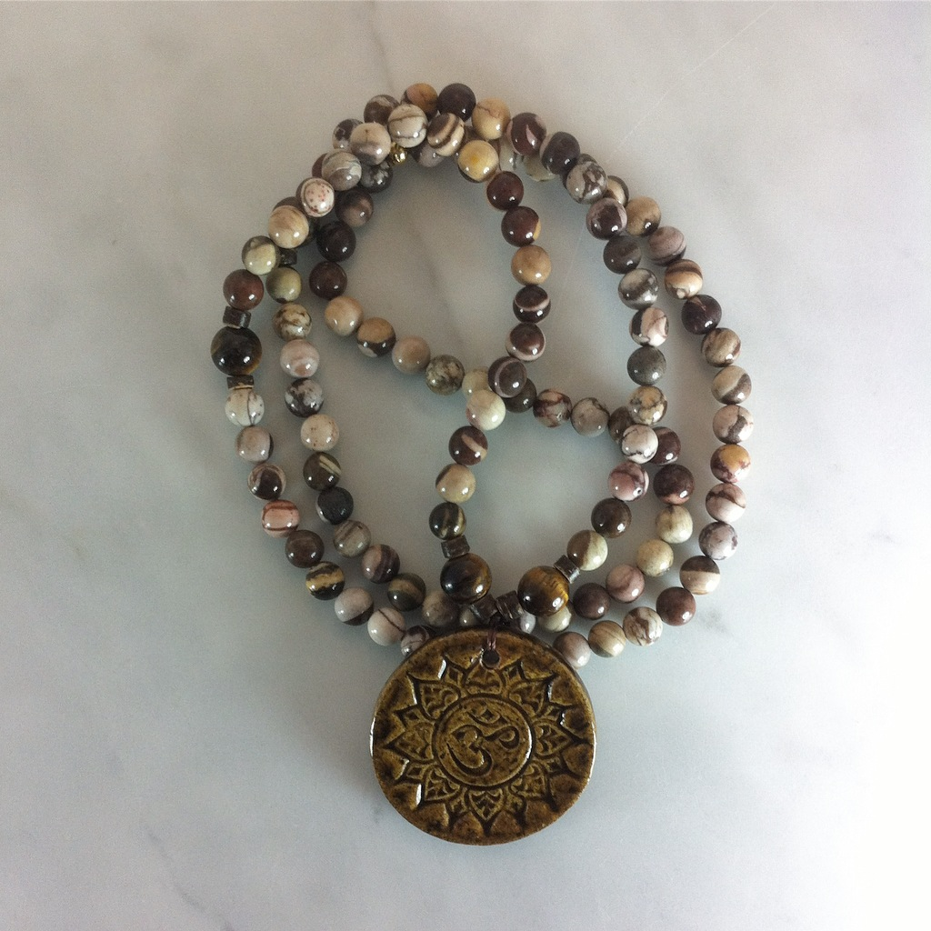 These mala beads are made from zebra jasper and tiger eye.