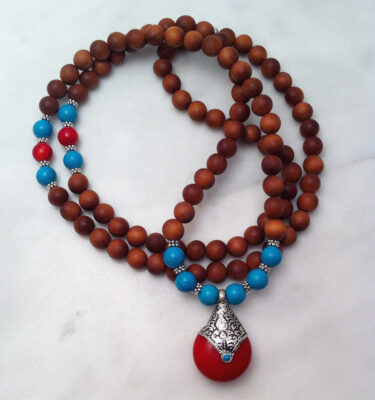 Sandalwood Mala Necklace with Tibetan Amulet